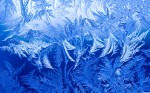 Ice crystals form on a window during sub zero temperatures