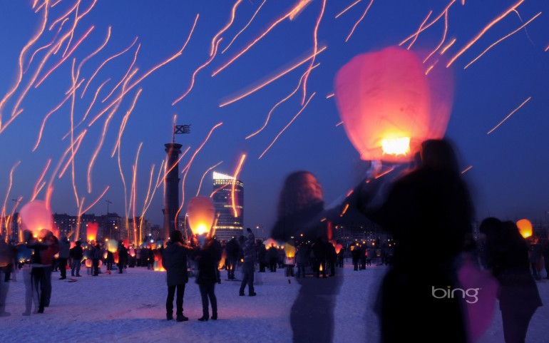 Long-exposure photograph of people launching paper lanterns on International Women's Day, St. Petersburg, Russia