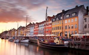 Colorful homes line Nyhavn Canal in Copenhagen, Denmark