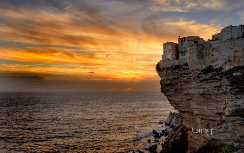 cliff at sea during sunset