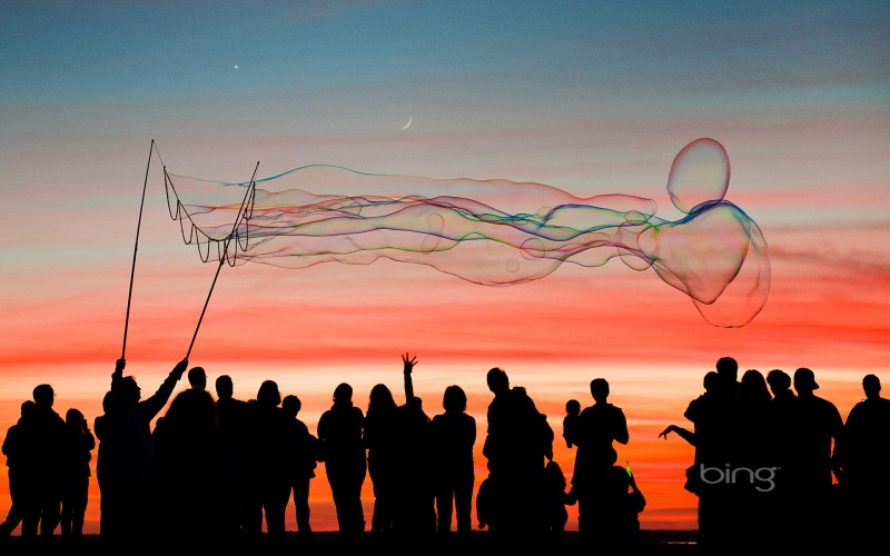 large soap bubbles at sunset